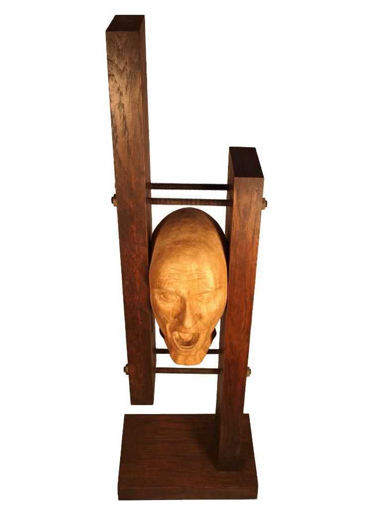 escultura de busto tallado en madera de roble
